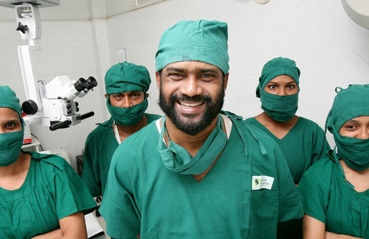 Smiling doctors and nurses in green scrubs at the Sajida Foundation in Bangladesh