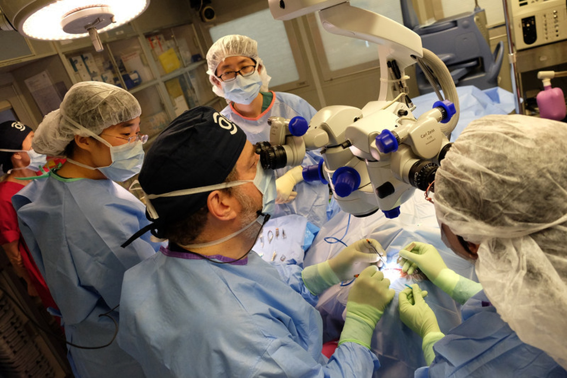 Doctors performing glaucoma surgery in China, led by Orbis volunteer Dr James Brandt