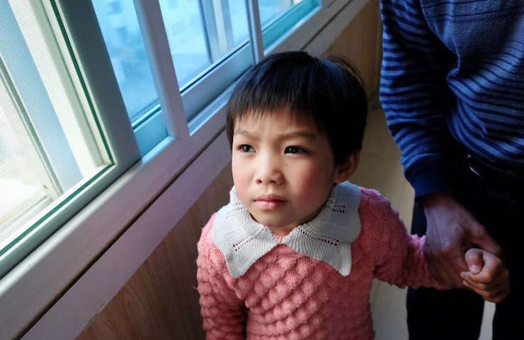 Chinese paediatric glaucoma patient Shunwen, in a pink dress
