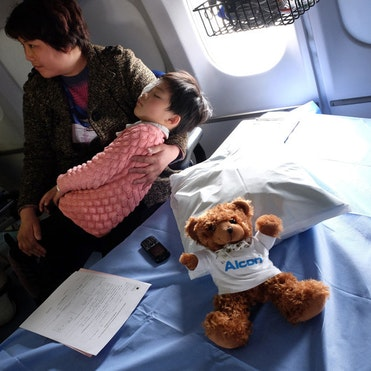 Chinese paediatric patient Shunwen in the recovery room after her operation for glaucoma