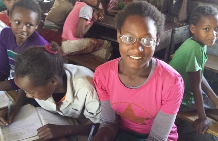 Ethiopian student Ajebush, who was treated for myopia, in the classroom with her friends