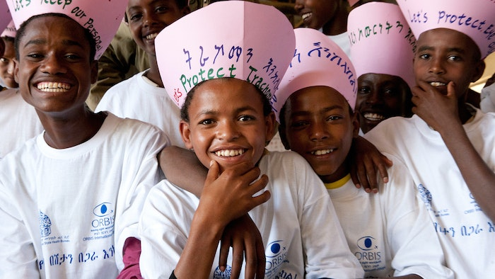 Smiling children promoting trachoma prevention.