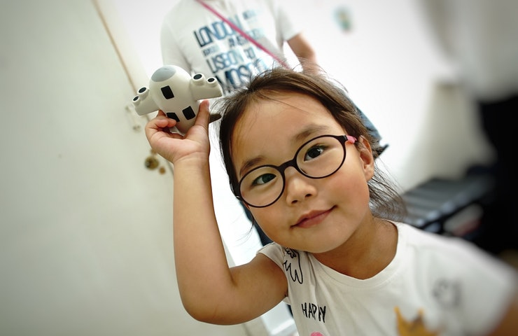 A little girl receiving eye treatment by volunteer faculty and local doctors during a project in Mongolia