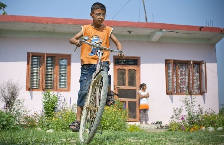 Child on a bike.