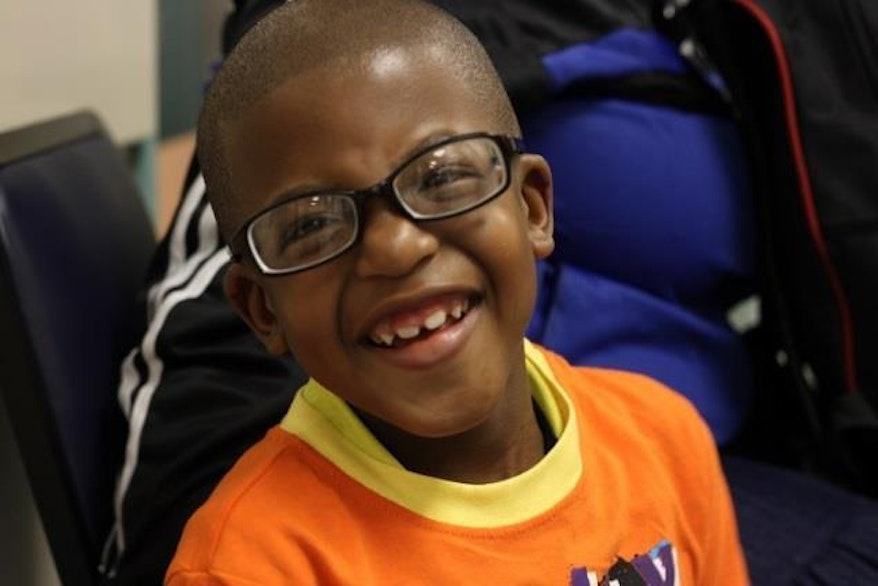 South African paediatric patient Braveman, who has a squint, wearing glasses