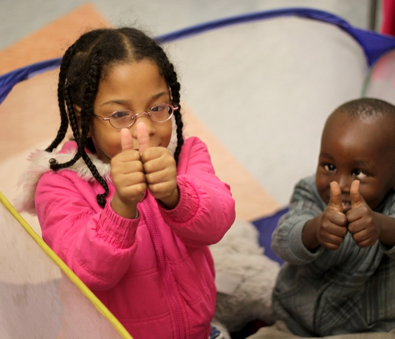 Paediatric patients Phoebe and Sbongakonke give a thumbs up while waiting at the IALS in Durban, South Africa