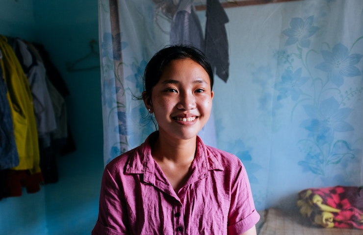 Vietnamese patient Trinh looks into the camera