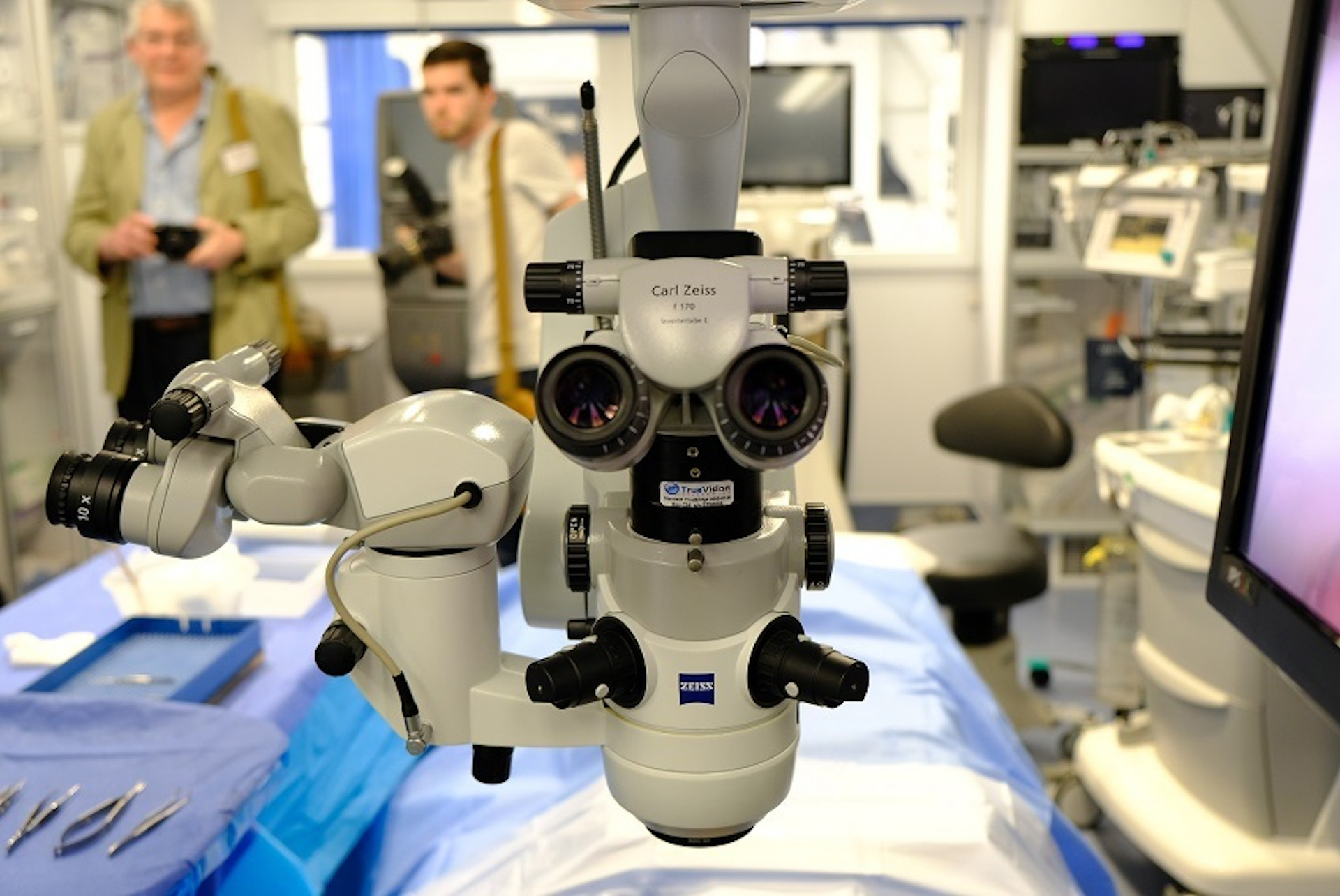 On board the Flying Eye Hospital, Ben Peet operates a microscope with the training arm