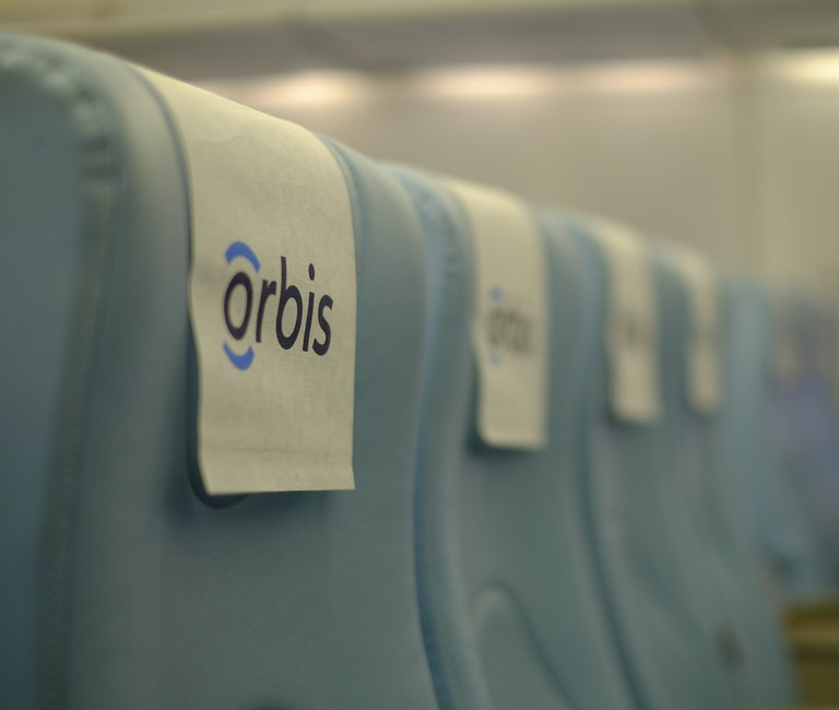 Classroom seats onboard the Flying Eye Hospital, which look just like normal plane seats, but in our blue colours