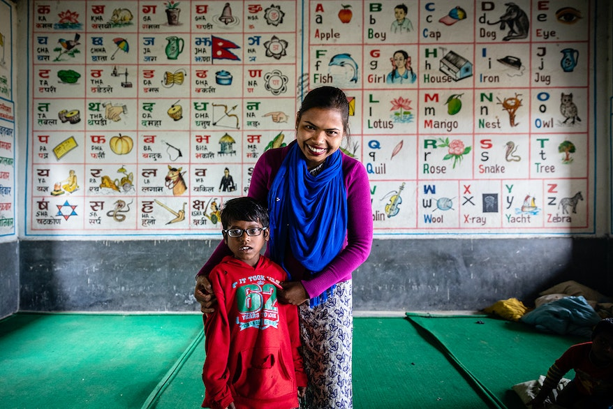 Rabi with his teacher Bharati who identified his vision problems while at school in Nepal