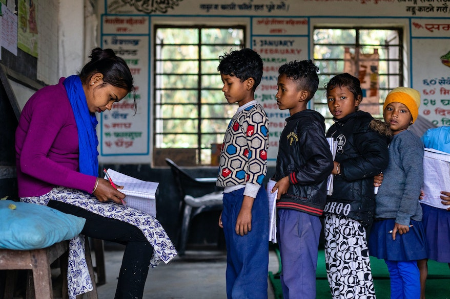 Bharati teaching her students at school in Nepal