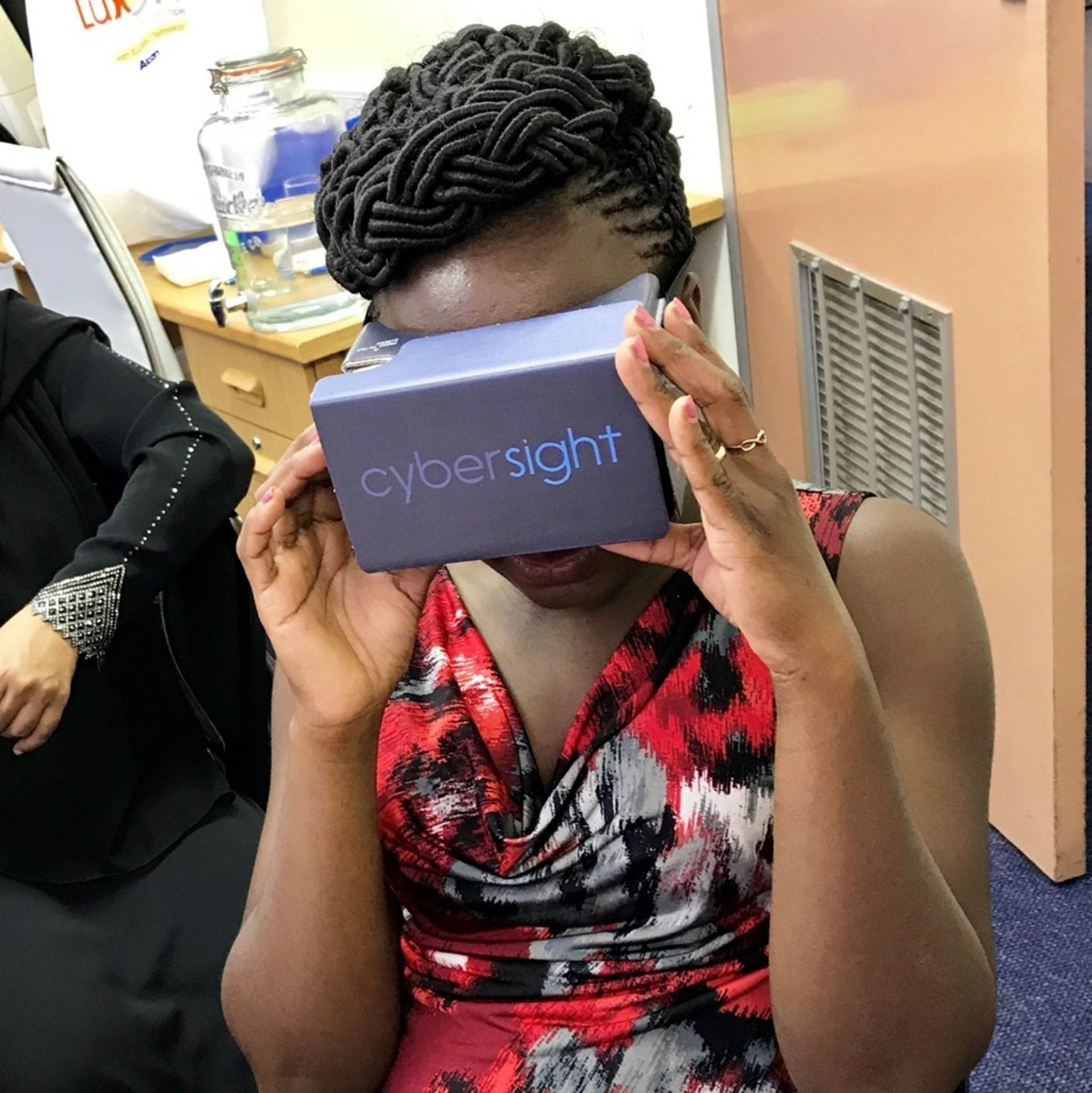 A local partner using virtual reality goggles for eye health training