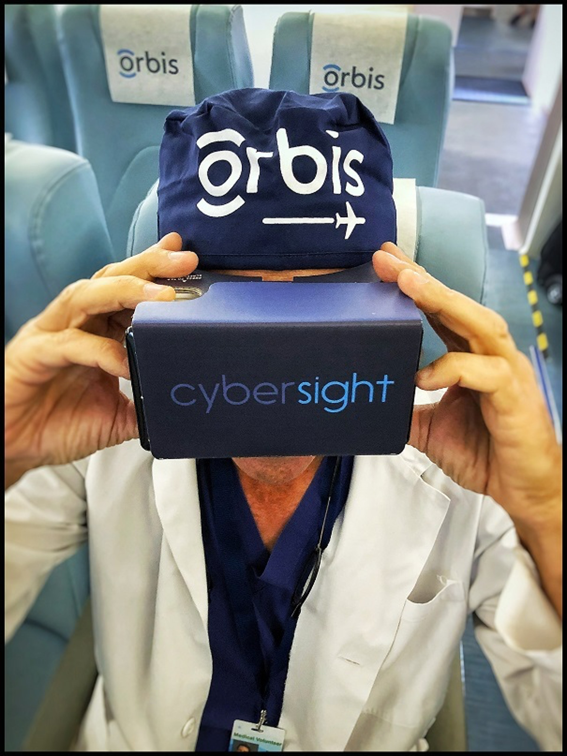 Dr. Daniel Neely using VR goggles for eye health training
