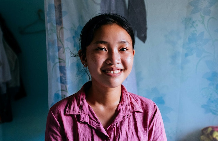 Trinh in her bedroom after her operation to correct strabismus