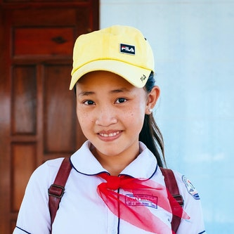 Trinh from Vietnam pictured in her school attire