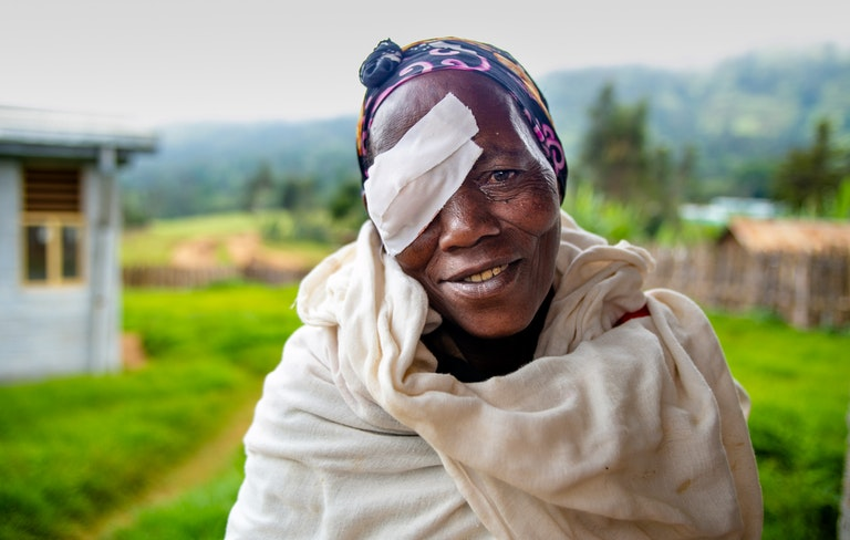 Elderly woman with eye patch in Ethiopia