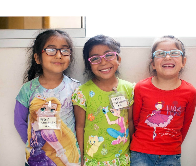 Young girls smiling in glasses.