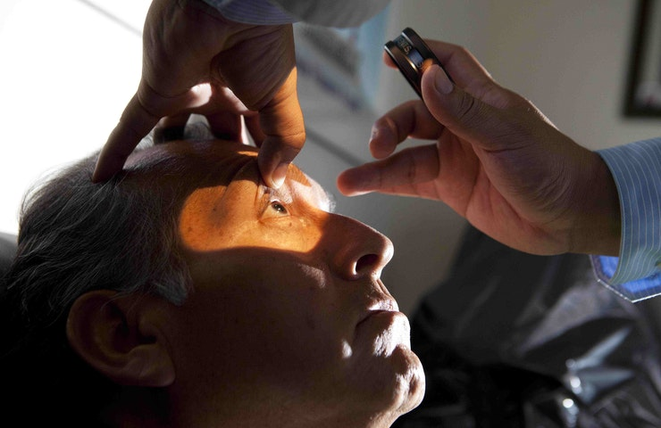A diabetic retinopathy patient in a retinal clinic is examined in Trujillo, Peru