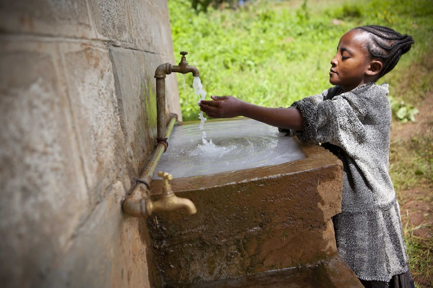 A child in Gamo Gofa Ethiopia visits a clean water point set up by Orbis to minimise the risk of catching trachoma