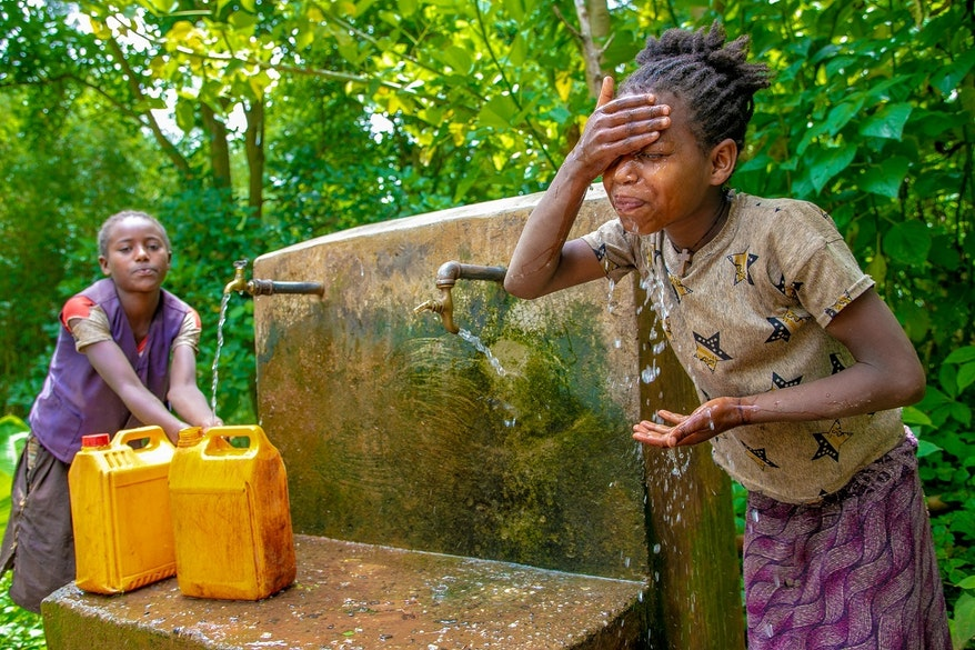 Two girls at a water point in Ethiopia