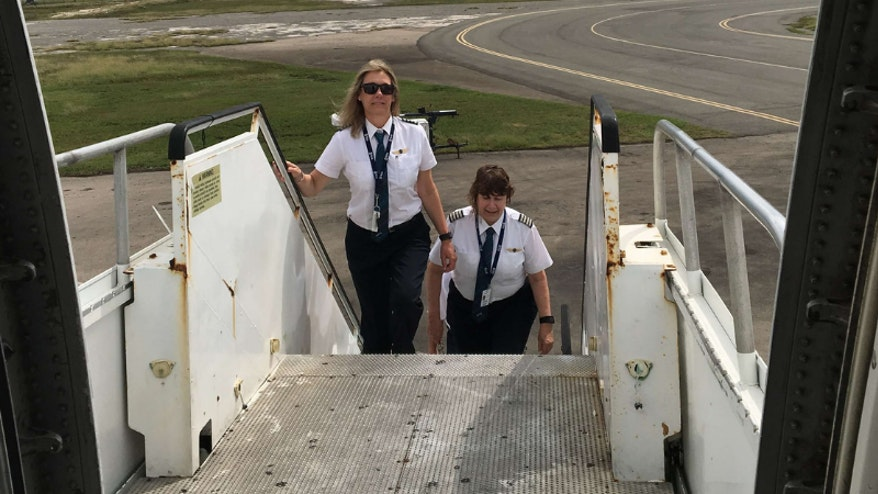Cyndhi and Cheryl stepping on board the Orbis Flying Eye Hospital in Memphis