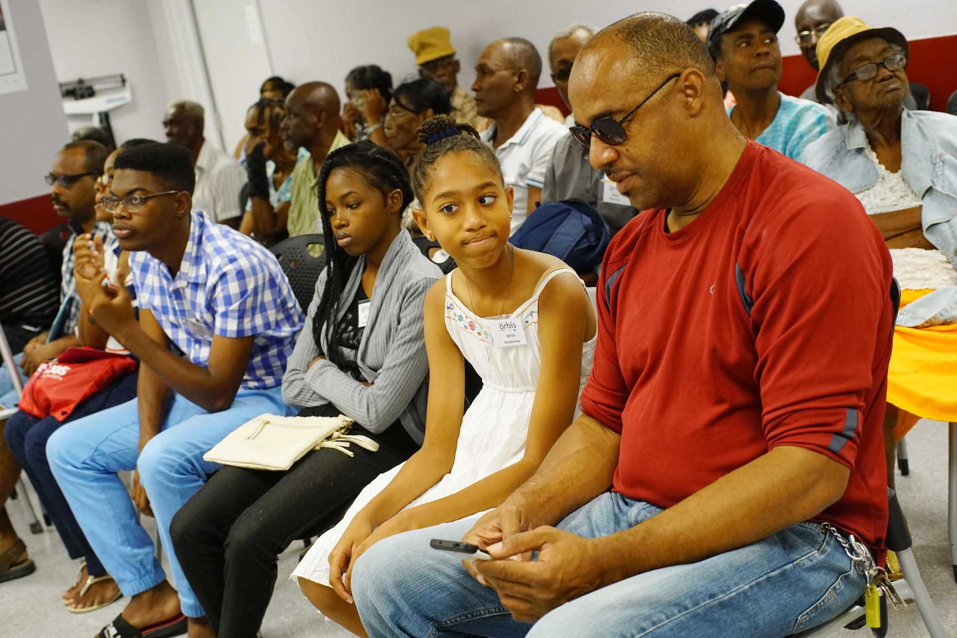 Savynna waits to be screened by eye teams during Orbis Flying Eye Hospital project in Barbados