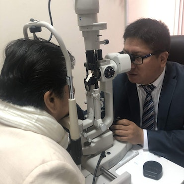 Orbis trainee Dr. De La Cruz screening patient 69-year-old Maria post-cataract surgery