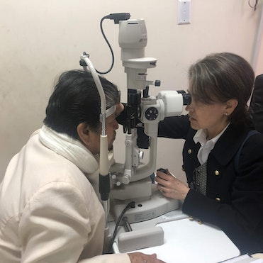 Dr. Laura Wayman screening patient 69-year-old Maria post-cataract surgery