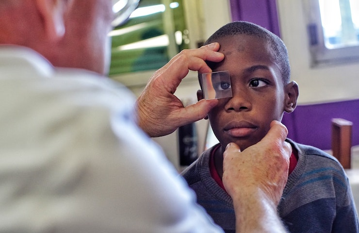 Young boy has his eye screened in Jamaica