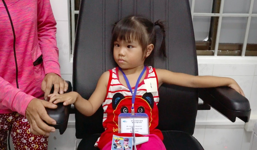 Year-end Orbis Appeal: Ly, who was struggling to see, sits patiently waiting to be screened