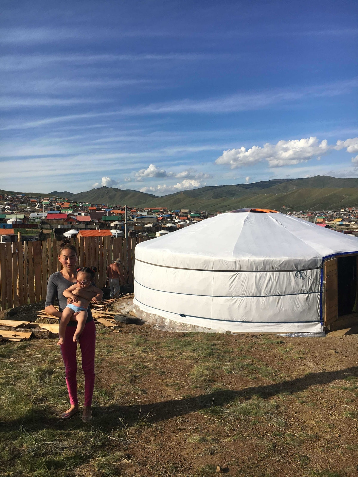 Marla and her mother outside their traditional ger in rural Mongolia