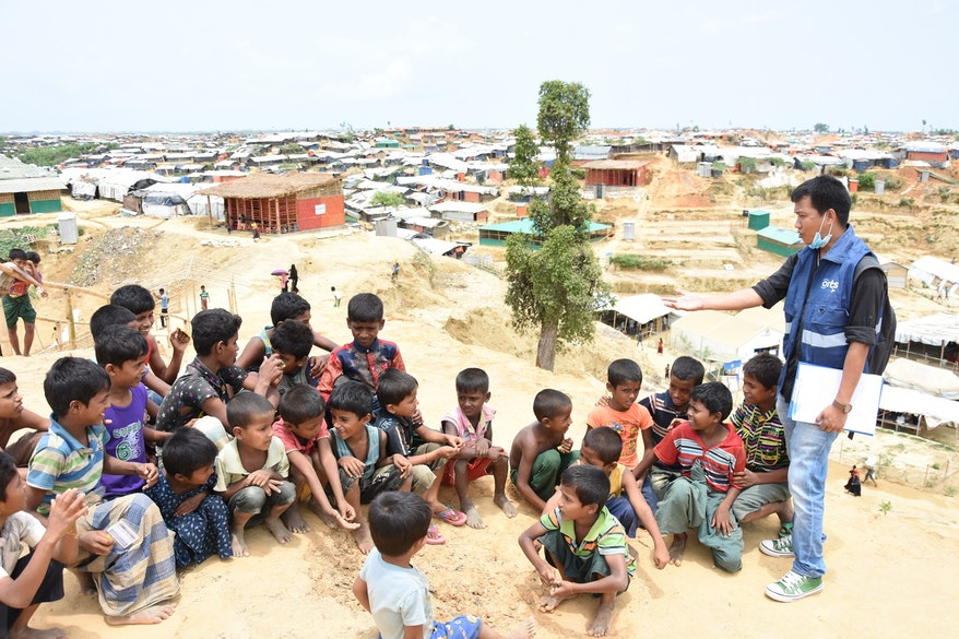 Rohingya children in a refugee camp in Bangladesh wait to be screened