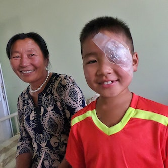 Cataract patient Nyamdorj pictured with his mother in Mongolia