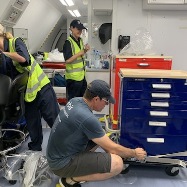 Members of the Orbis team pack up the Flying Eye Hospital after three weeks