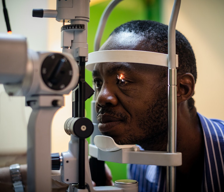 A man is screened for diabetic retinopathy during Flying Eye Hospital project in Barbados