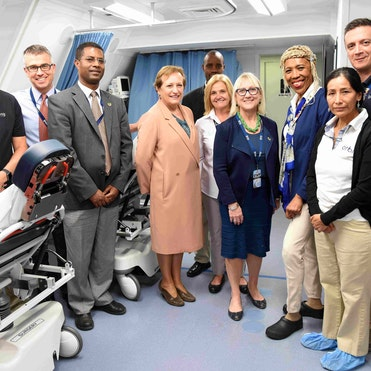 Dr. Sisay British with the British Ambassador to Ethiopia with volunteer faculty, clinical staff and crew on the Orbis Flying Eye Hospital in 2018