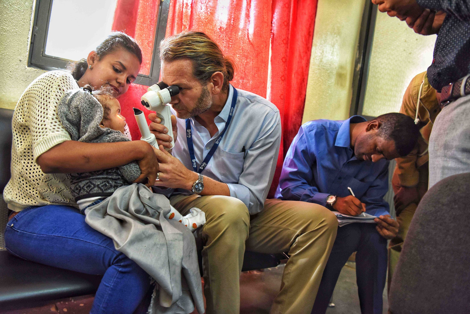 Volunteer Faculty Dr. Daniel Neely screening a baby in Ethiopia