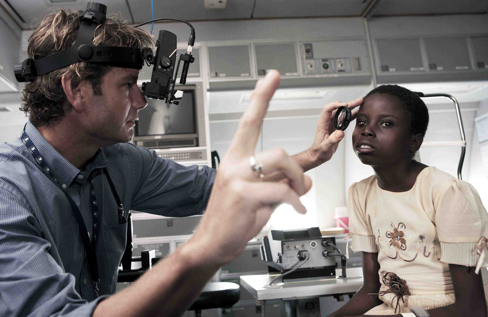 Volunteer Faculty Dr. Daniel Neely screening a child in Zambia