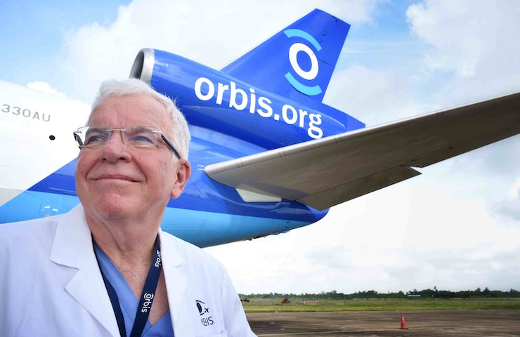 Ophthalmologist and glaucoma specialist Dr. Wallace L.M. Alward outside of the Orbis Flying Eye Hospital