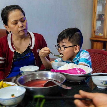 Cataract patient Tam, 5 years, at home with his mother Thao