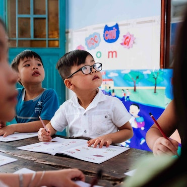 Cataract patient Tam, 5 years, sat in school after surgery on his bilateral cataracts