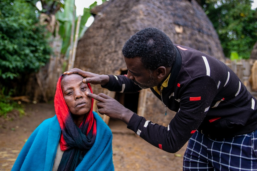 A woman in Ethiopia receives eye drops for trachoma administered by an Orbis-trained eye care worker